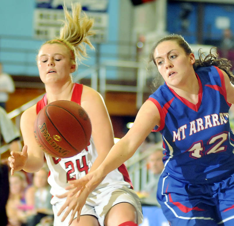 RAMS: Cony High School's Emily Sanford, left, is stripped of the ball by Mt. Ararat High School's Mallory Nelson during a basketball match up Wednesday in Augusta.