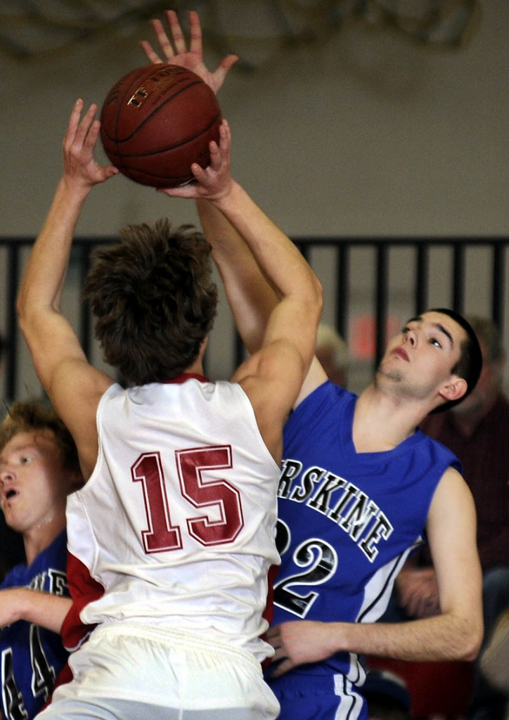 BLOCK SHOT: Erskine Academy's Shyler Scates, right, blocks Cony High School's Josiah Hayward Wednesday during a basketball match up in Augusta. At left is Erskine's Tyler Belanger.