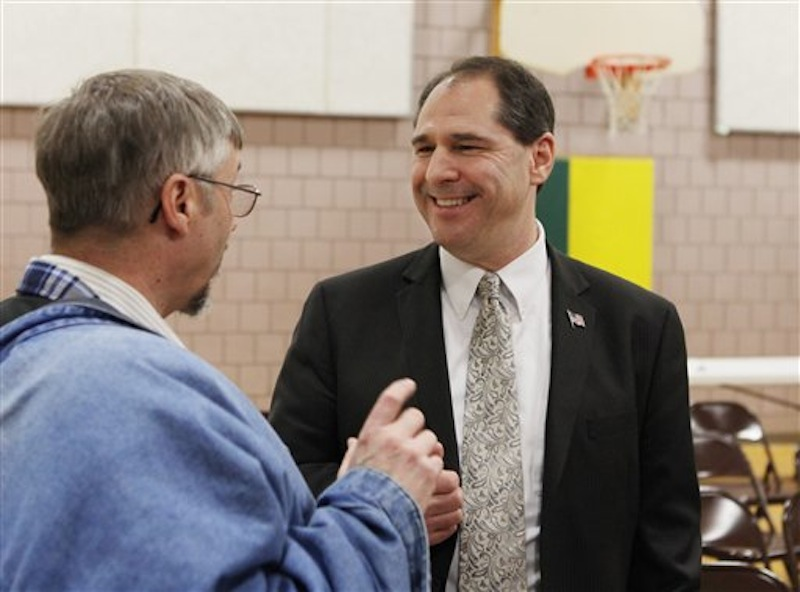 Senatorial hopeful Scott D'Amboise, speaks with an unidentified supporter during the Kennebec County Super Caucus in Augusta, Maine on Saturday, Feb. 4, 2012. (AP Photo/Joel Page)