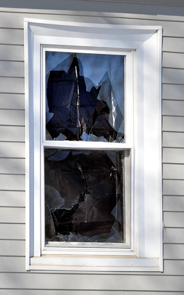 One of three broken windows at Justin DePietro's residence at 29 Violette Ave.