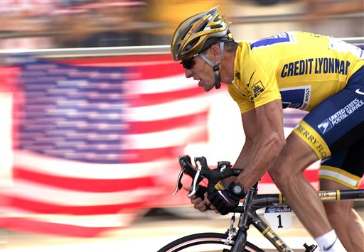 Lance Armstrong rides down the Champs Elysees during the 20th and last stage of the Tour de France in this July 25, 2004, photo.
