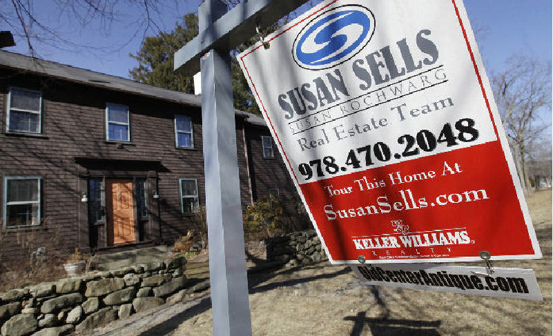 A home is for sale in North Andover, Mass. Sales of previously occupied U.S. homes rose in January to the highest pace in nearly two years, a hopeful sign ahead of the spring-buying season. (AP Photo)