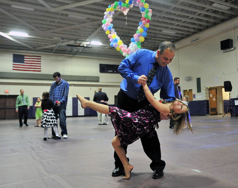 Rick Michaud dances with his daughter Emma, 6, at the 18th Annual Father/Daughter Dance at Waterville Junior High School Friday night.