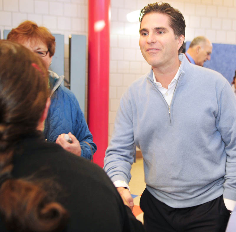 Tagg Romney greets voters before the Kennebec County Super Caucus at Farrington School in Augusta on Saturday.