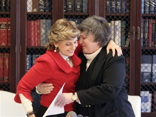 Robin Tyler, right, who with her partner Diane Olson, not shown, became the first same-sex couple to wed in Los Angeles County in 2008, embraces her attorney Gloria Allred after hearing the 9th U.S. Circuit Court of Appeals' decision validating same-sex marriage.