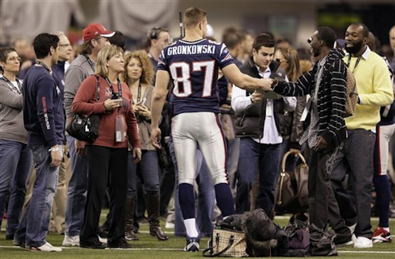 New England Patriots tight end Rob Gronkowski (87) greets people in Lucas Oil Stadium on Saturday, Feb. 4, 2012, in Indianapolis. (AP Photo/Mark Humphrey)
