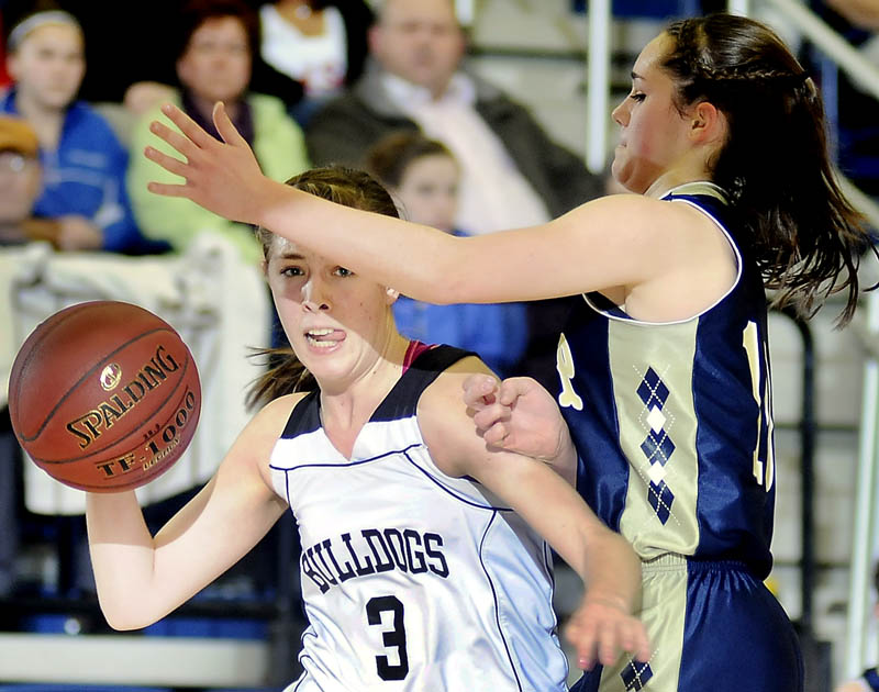 WHO'S OPEN: Hall-Dale High School's Kristina Buck, left, gets ready to make a pass around the defense of R.W. Traip Academy's Alli Barrett during a Western Maine Class C girls basketball semifinal Thursday at the Augusta Civic Center.