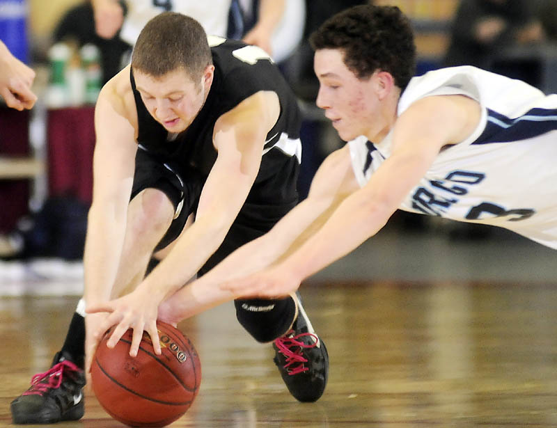 Staff photo by Andy Molloy BULLDOG BITE: Hall-Dale High School's Tyler French, left, and Dirigo High School's Caleb Turner dive for the ball during a tournament basketball match up Thursday in Augusta.
