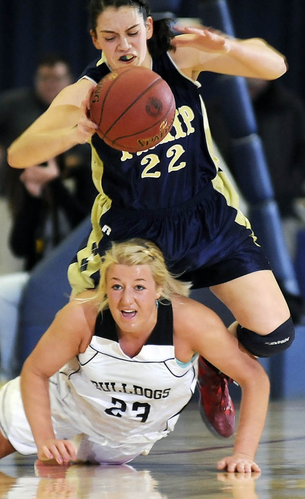 Hall-Dale High School's Carylanne Wolfington, bottom, comes up after scrambling for the ball with R.W. Traip Academy's Selene Lorrey during a tournament basketball match up Thursday in Augusta.