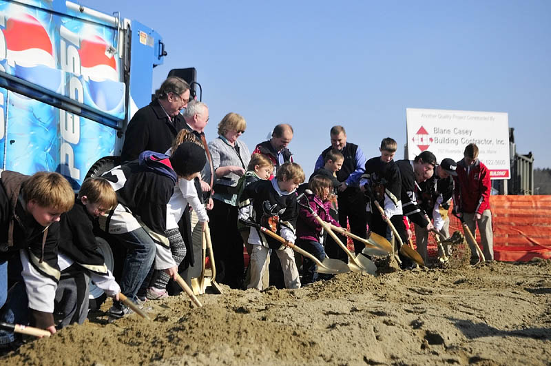 DIGGING IN: Young skaters and hockey players join in the ceremonial groundbreaking for the ice new rink, which will be called the Bank of Maine Ice Vault, on Thursday afternoon in Hallowell.