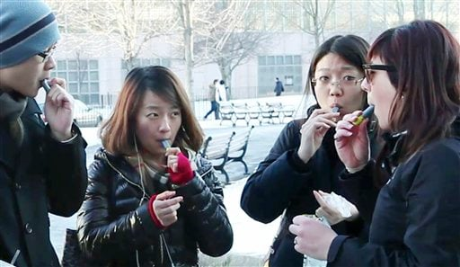 In this recent image taken from video, students try free samples of AeroShot on the campus of Northeastern University in Boston. Harvard University engineering professor David Edwards created AeroShot.