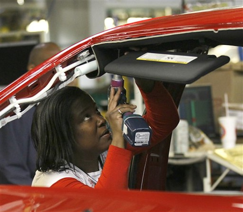 An auto worker assembles parts on the 2013 Dodge Dart at the Chrysler Plant in Belvidere, Ill. on Thursday, Feb. 2. The unemployment rate fell for the fifth straight month after a surge of January hiring by U.S. companies. (AP Photo/Charles Rex Arbogast)