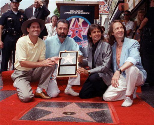 A 1989 photo of The Monkees. From left: Micky Dolenz, Mike Nesmith, Davy Jones and Peter Tork pose with their star on the Hollywood Walk of Fame in Los Angeles