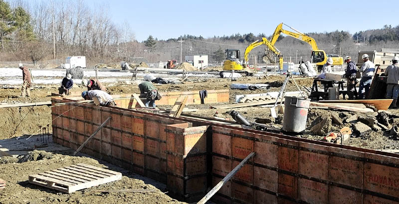 Workers build the foundation for the new Kennebec Ice Arena on Friday in Hallowell.
