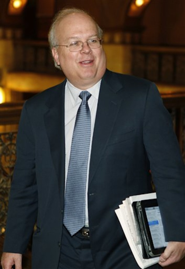 "In this June 2011 photo, GOP strategist Karl Rove arrives at the Brown Palace Hotel in Denver, where he addressed Republicans at a fund raising luncheon. American Crossroads, the Republican ""super"" political committee that plans to play a major role in this year's presidential campaign, raised more than $51 million along with its nonprofit arm last year. (AP Photo/Ed Andrieski, File)"