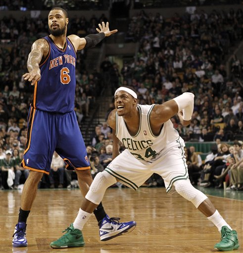 Boston Celtics' Paul Pierce (34) and New York Knicks' Tyson Chandler (6) watch a 3-point shot by Pierce during the second quarter Friday in Boston.