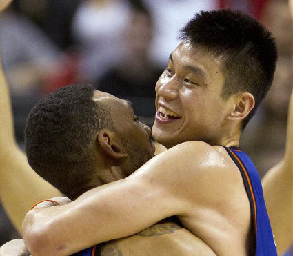 New York Knicks guard Jeremy Lin, right, celebrates with teammate Jared Jeffries after his game-winning 3-pointer in the final seconds of the game against the Toronto Raptors in Toronto on Tuesday The Knicks won 90-87.