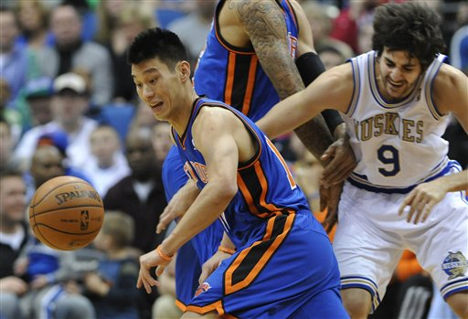 New York Knicks' Tyson Chandler, center, sets a pick on Minnesota Timberwolves' Ricky Rubio, right, of Spain, as Knicks' Jeremy Lin, left, chases the loose ball in the first half of an NBA basketball game on Saturday in Minneapolis.