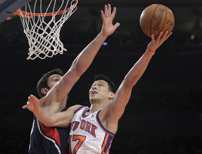 Knicks guard Jeremy Lin goes up for a layup against Atlanta Hawks center Zaza Pachulia in the first quarter of Wednesday night's game at Madison Square Garden.