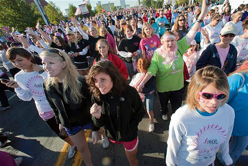 In this Saturday, Oct. 16, 2010 photo, some of an estimated 45,000 people participate in the Susan B. Komen Race for the Cure in Little Rock, Ark. (AP Photo/Brian Chilson)