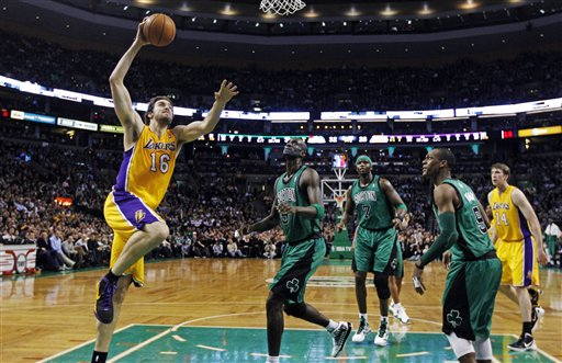 Los Angeles Lakers power forward Pau Gasol (16) drives to the basket past Boston Celtics' Kevin Garnett, center, Jermaine O'Neal (7), Rajon Rondo (9) and Lakers' Troy Murphy (14) during the first quarter of an NBA basketball game in Boston, Thursday, Feb. 9, 2012. Gasol contributed 25 points as the Lakers won 88-87 in overtime. (AP Photo/Charles Krupa)