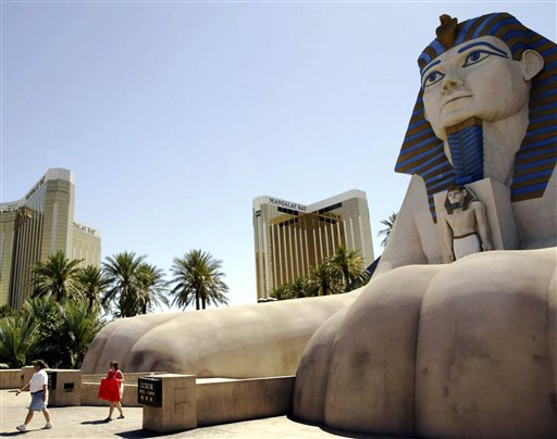Pedestrians walk near the Mandalay Bay towers in Las Vegas in this file photo.