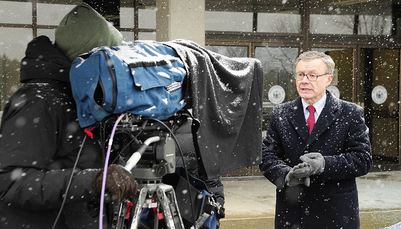 IN THE PUBLIC EYE: Maine State Police spokesman Steve McCausland stands in the snow outside the Department of Public Safety in Augusta as he is interviewed via satellite about the Ayla Reynolds case on a national news show on Tuesday afternoon.