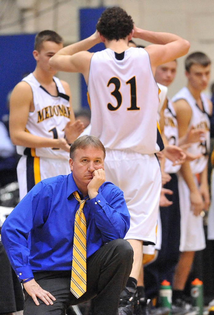 Photo by Michael G. Seamans Medomak Valley High School head coach Nicholas DePatsy reacts after a technical foul for too many men on the floor in the second half of the Eastern Class B semi-finals at the Bangor Auditorium Wednesday. Gardiner defeated Medomak Valley 57-46.