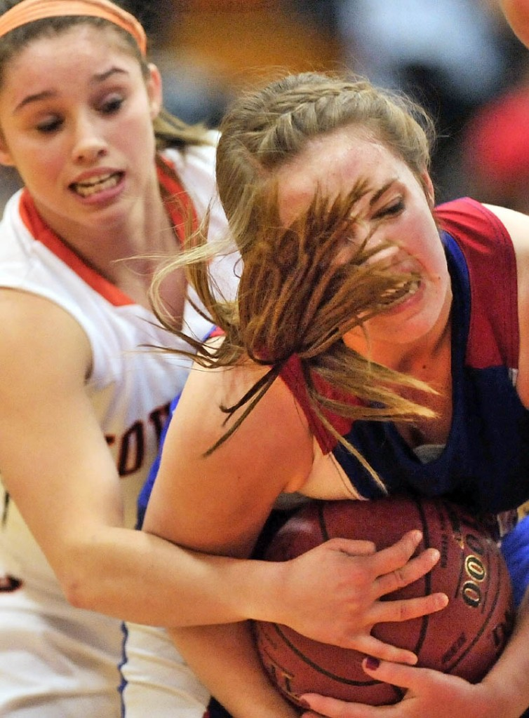 GIVE ME: Messalon-skee High School's Kassi Michaud, right, battles for the ball with Skowhegan Area High School's Natasha Thompson in the second quarter Friday night in Skowhegan.