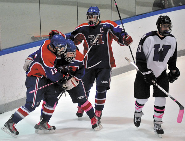 NEXT STEP: Messalonskee teammates, from left, Chase Cunningham, James Varney and Sam Dexter will host No. 7 John Bapst at 6 tonight at Sukee Arena. The Eagles finished two regular-season victories shy of matching the program record of 17.