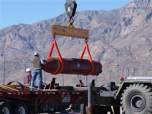 A weapon like this 30,000-pound penetrating bomb could be used in any attack on Iran's nuclear facilities. This photo provided by the Defense Threat Reduction Agency shows crews loading the bomb for a test at White Sands Missile Range in southern New Mexico in 2007.