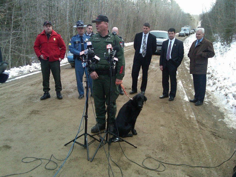 Game Warden Norman Lewis, with other officials, answers questions at a news conference on Wednesday in Newburgh, where authorities found the body of missing firefighter Jerry Perdomo. Daniel Porter has been charged in the killing.