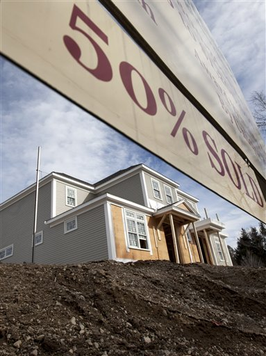 This Feb. 8, 2012, shows a home under construction at a planned community in Medfield, Mass.
