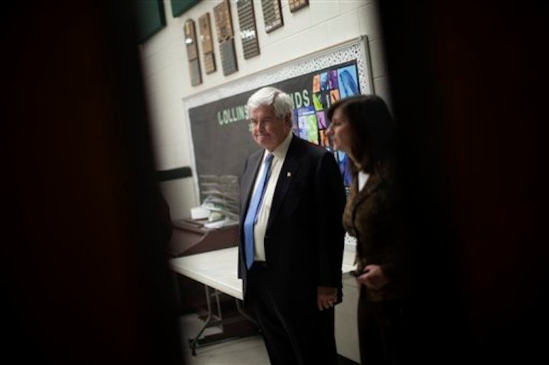 Republican presidential candidate and former House Speaker Newt Gingrich waits in a holding room before speaking at a campaign stop Saturday, Feb. 18, in Suwanee, Ga. (AP Photo/Evan Vucci)
