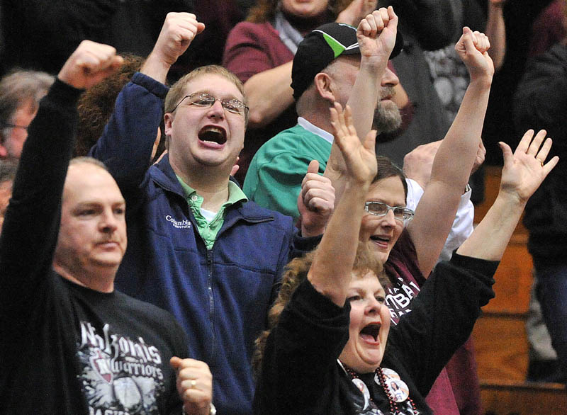 Photo by Michael G. Seamans Nokomis High School fans cheer a basket in the first half of the Eastern Class B quarterfinals game at the Bangor Auditorium Saturday. Nokomis defeated Medomak Valley 58-51.