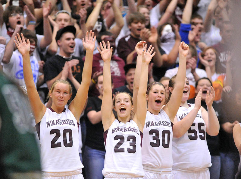 Photo by Michael G. Seamans Nokomis High School teammates from left to right Emilee Reynolds, 20, Kelsie Richards, 23, Anna Mackenzie, 30, and Traci Carson, 55, celebrate after defeating Old Town High School 52-31 of the Eastern Class B semi-finals at the Bangor Auditorium Wednesday.