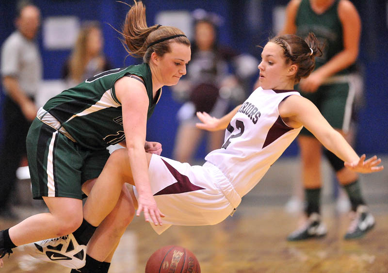 Photo by Michael G. Seamans Nokomis High School's Kylie Richards, 12, draws the offensive foul from Old Town High School's Ashley England in the first half of the Eastern Class B semi-finals at the Bangor Auditorium Wednesday.