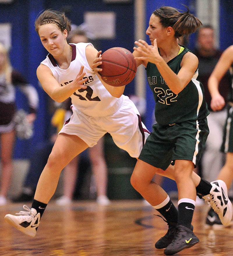 Photo by Michael G. Seamans Nokomis High School's Kylie Richards, 12, makes a steal in front of Old Town High School's Ashley Abbott, 32, in the first half of the Eastern Class B semi-finals at the Bangor Auditorium Wednesday.