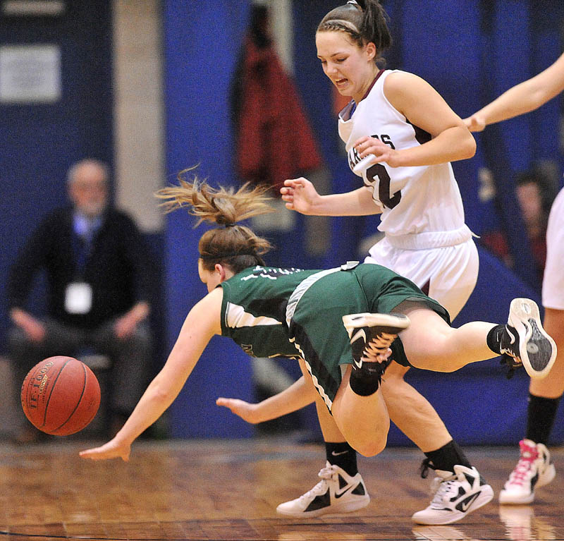 Photo by Michael G. Seamans Old Town High School guard Ashley England, 10, goes down as she is defended by Nokomis High School's Kylie Richards, 12, in the first half of the Eastern Class B semi-finals at the Bangor Auditorium Wednesday.