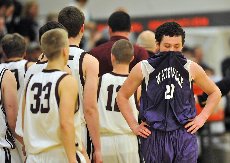Photo by Michael G. Seamans Waterville Senior High School's Josh Gromley, 20, far right, reacts after losing to Nokomis High School 50-49 in overtime at Nokomis High School in Newport Wednesday night.
