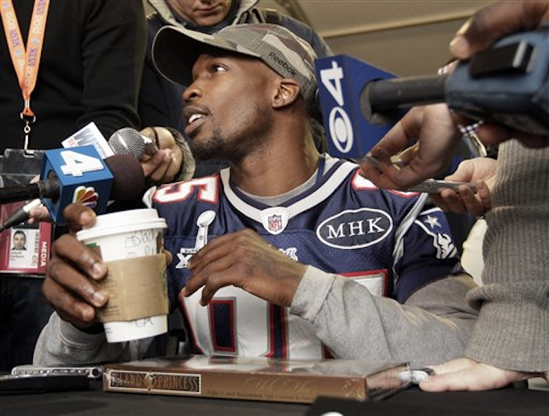 New England Patriots wide receiver Chad Ochocinco answers questions during a news conference on Wednesday, Feb. 1, 2012, in Indianapolis. (AP Photo/Mark Humphrey)