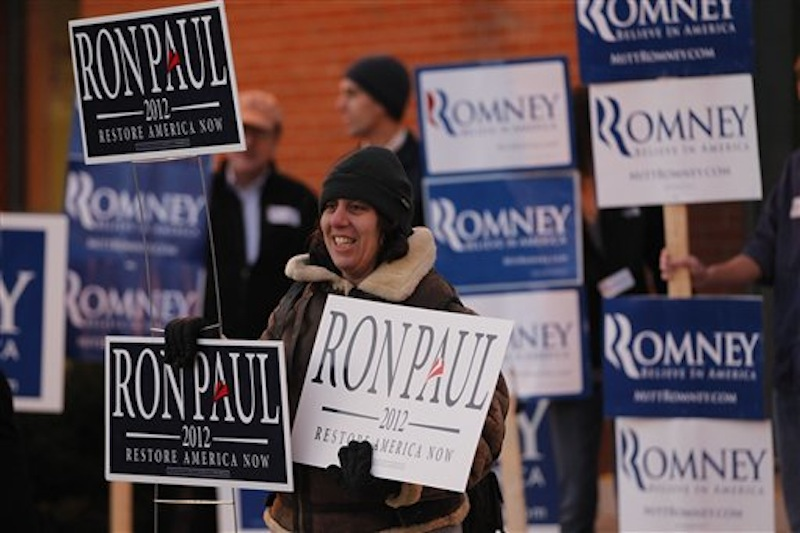 Merav Yaakov hold signs in support of Republican presidential candidate, Rep. Ron Paul, R-Texas, outside a scheduled event for Republican presidential candidate Mitt Romney. (AP Photo/Matt Rourke)