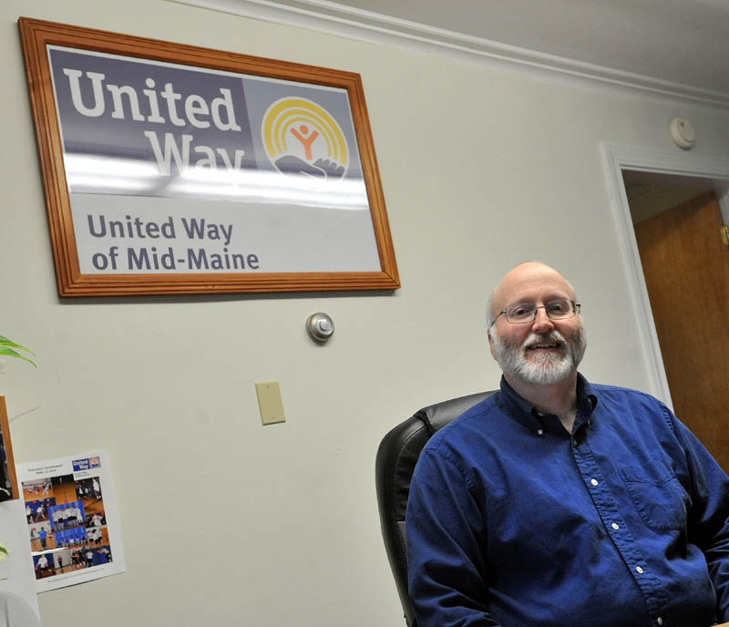 AT WORK: Peter Lyford, resource development coordinator for United Way at Mid-Maine, Inc., in his office on Friday:
