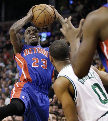 Detroit Pistons guard Walker Russell (23) passes to a teammate as Boston Celtics guard Avery Bradley (0) defends during the first half Wednesday in Boston.