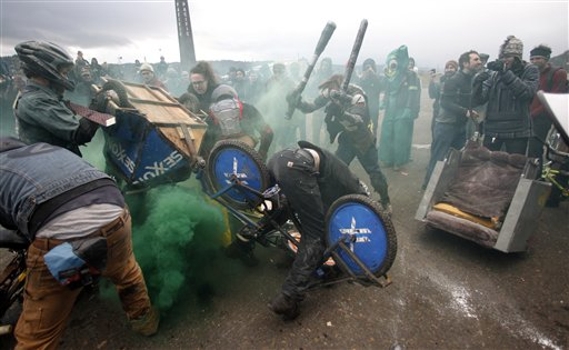 """Chariot riders battle in a """"Ben Hur""""-like race called the Chariot Wars on Saturday in Portland, Ore."""
