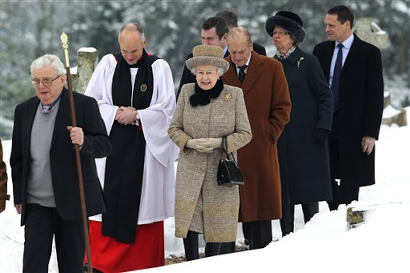 Britain's Queen Elizabeth II, centre, and her husband Prince Philip, 3rd right, arrive at the church of St. Peter and St. Paul at West Newton on Sunday. (AP Photo/PA, Chris Jackson) wparota