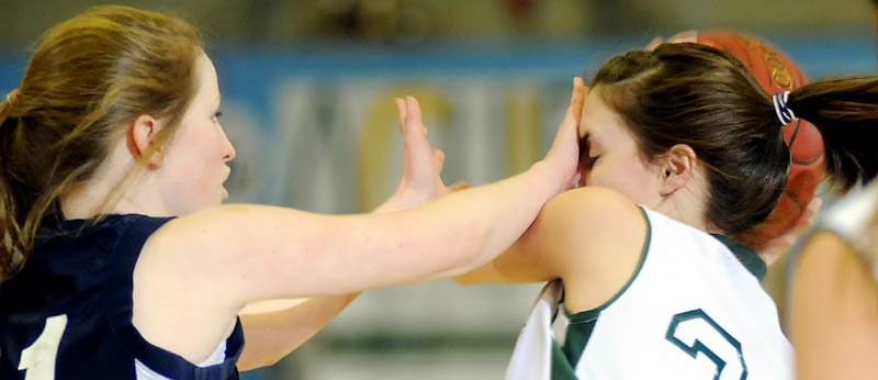 FACE TIME: Rangeley Lakes Regional School's Emily Carrier, right, is fouled by Greater Portland Christian School's Jessica Smith during a Western Class D quarterfinal game Monday at the Augusta Civic Center.
