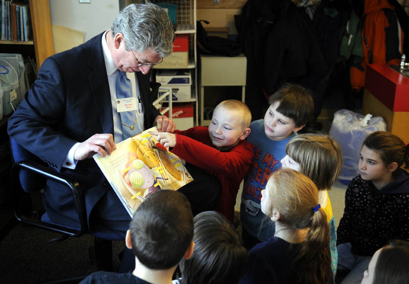 Augusta Mayor William Stokes gets some help Monday reading a book from first-grade students attending Moe Heikkila's class at Lincoln Elementary School in Augusta. Stokes and several other prominent Augusta citizens read to the children as part of a readathon at the school.