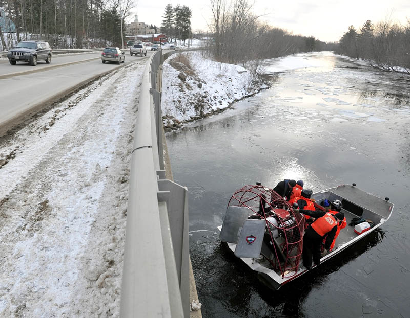 Authorities clear Messalonskee Stream of ice with an air boat near North Street bridge in Waterville Saturday morning.