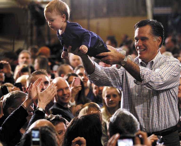 Republican presidential candidate, former Massachusetts Gov. Mitt Romney holds One-year-old Madison Busch during a campaign rally in Loveland, Colo., Tuesday, Feb. 7, 2012. (AP Photo/Gerald Herbert)